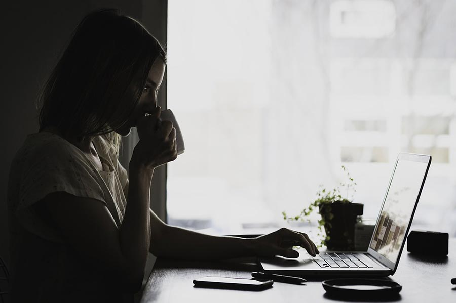 Therapy Services - Working Online - Woman and Laptop